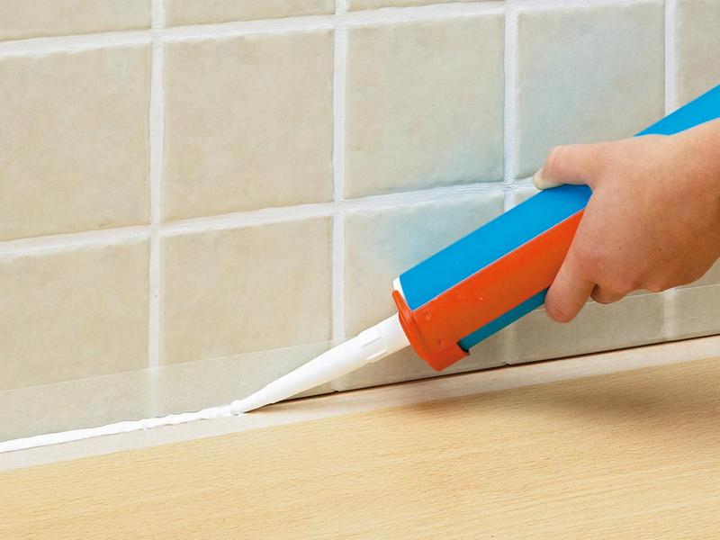 remove silicone sealant from tile