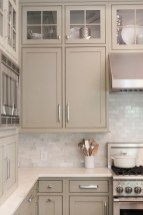 Cream Kitchen Cabinets With Light Grey Walls Backsplash