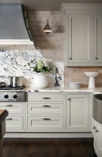 Cream Kitchen Cabinets With Stainless Appliances