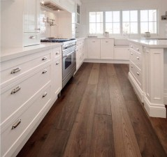 Cream Kitchen Cabinets With Wood Floors and White Granite Countertops