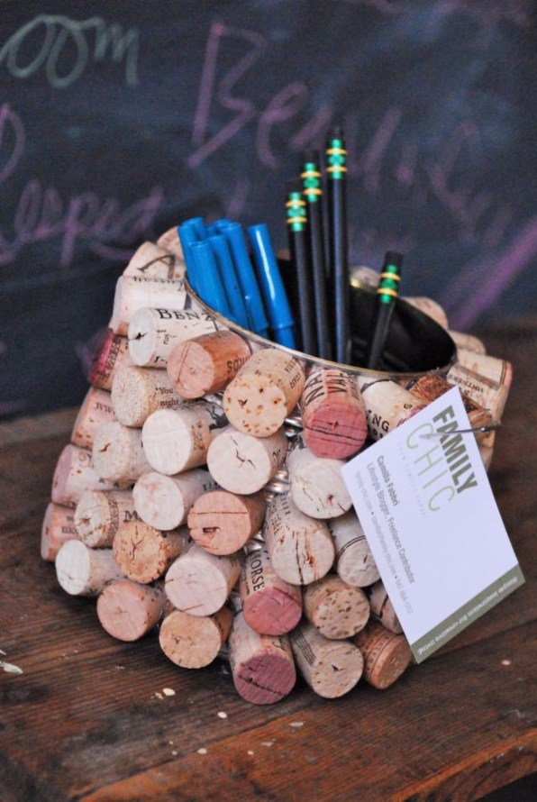 A Tin Can Pencil Case with Corks Attached to Its Surface
