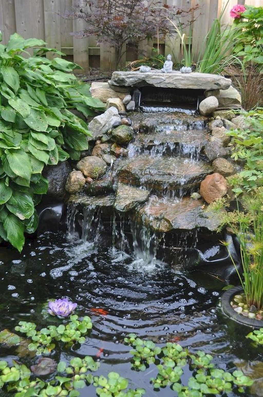 Creative Backyard Ponds Ideas With Waterfalls To Try 17