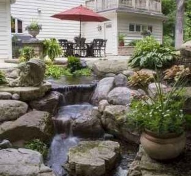 Creative Backyard Ponds Ideas With Waterfalls To Try 23