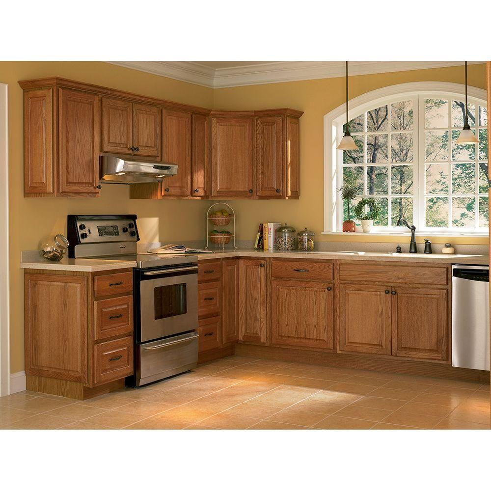 Medium Oak Cabinets With Black Countertops
