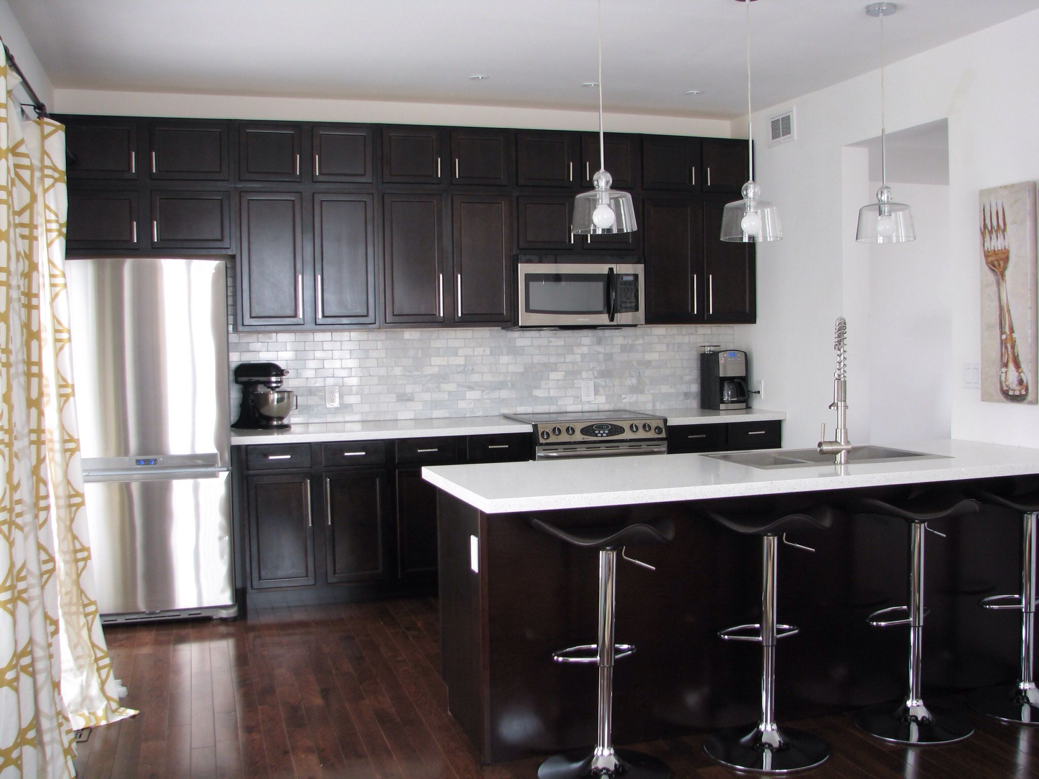 Kitchens With Brown Cabinets And Black Countertops