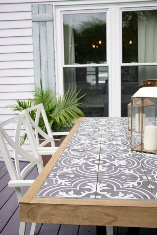 DIY Farmhouse outdoor dining table with a tile top.