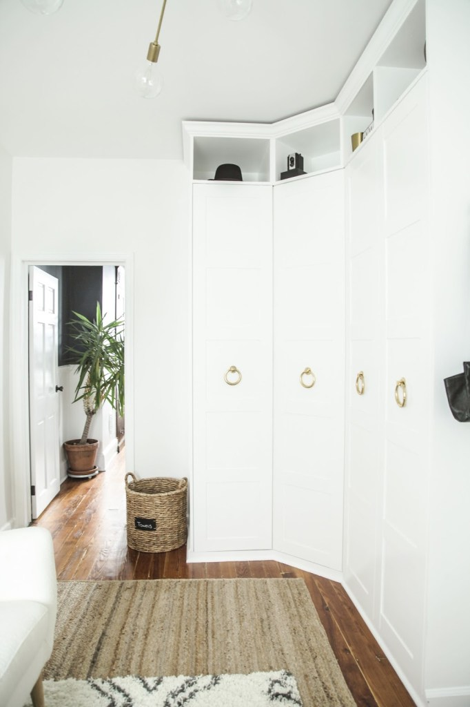 L Shaped storage for a sophisticated dressing room.