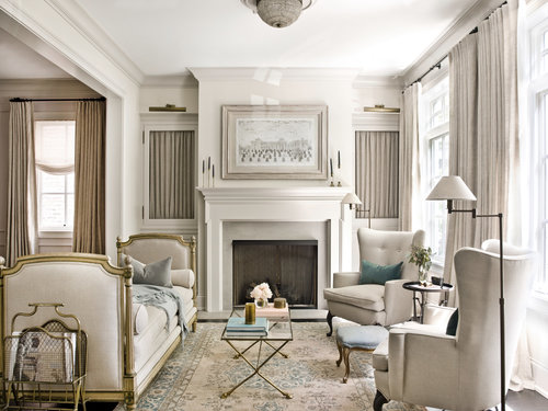 Beige designed living room with table, sofa, chairs and firework