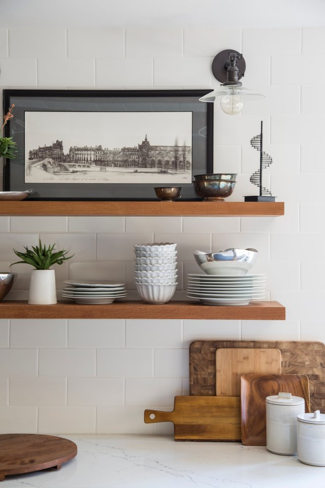 Kitchen shelf with pictures, plant and jars