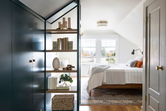Bedroom with book shelf and vases