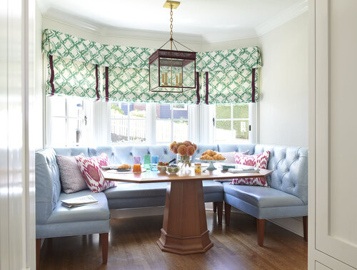 Room with chairs around the table and big windows