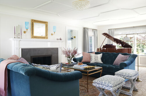 Living room with firework, sofas, table and chairs