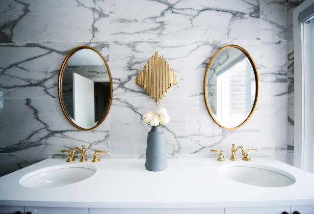 Two bathroom syncs and two mirrors