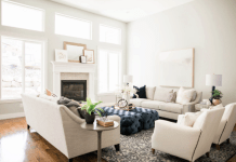 Living room with white armchairs and sofa