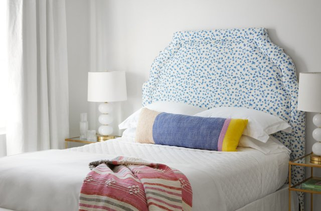 Bedroom with with bed, night stand and lamp