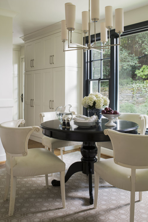 Dining room with dark table and white chairs