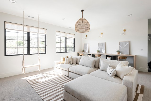 Bright designed living room with big couch