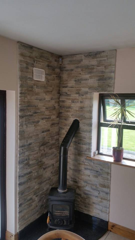 wall behind stove fireplace cladding