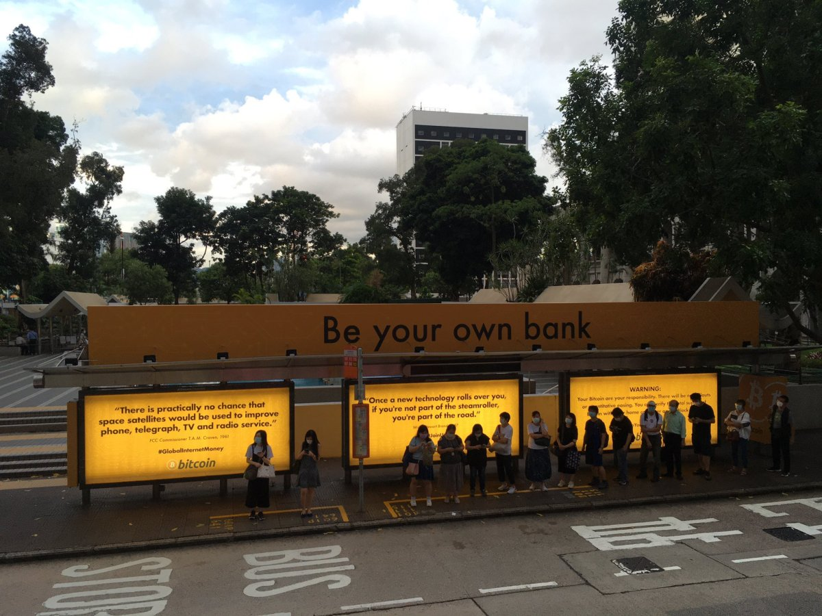 a bus stop with bitcoin ads