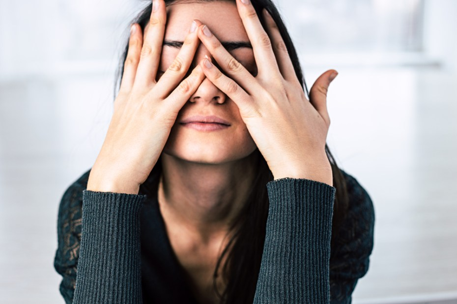 woman covering her face stressed out