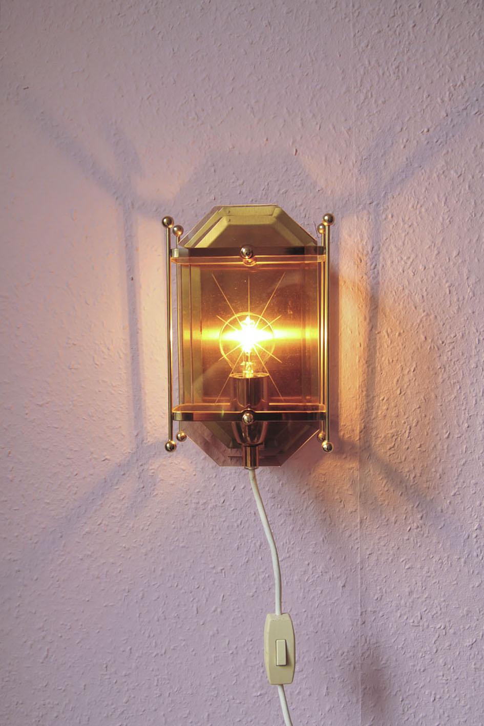 set gouden wandlampjes gerookt glas
