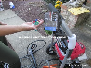 The nozzles are color coded and the reference sheet is attached to pressure washer