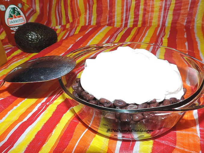 Mix sour cream and beans in a bowl and microwave