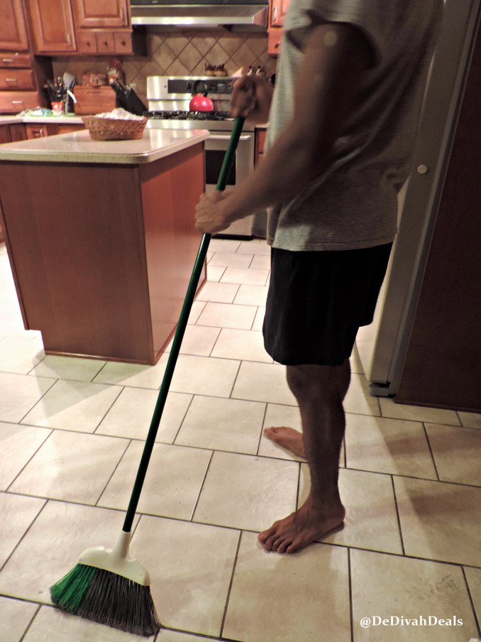 son sweeping the floor