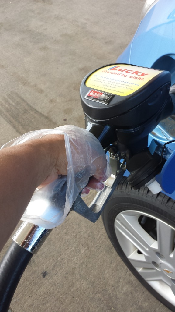 pumping gas in plastic gloves