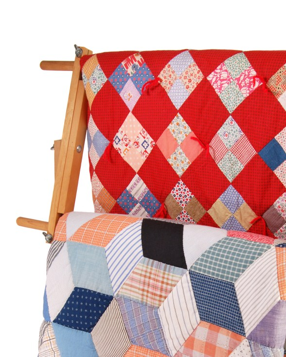Two Quilts On A Wood Rack