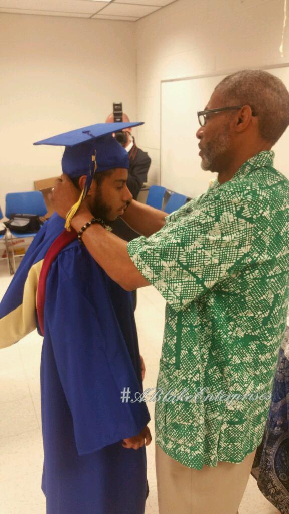 helping Tayair get ready for graduation