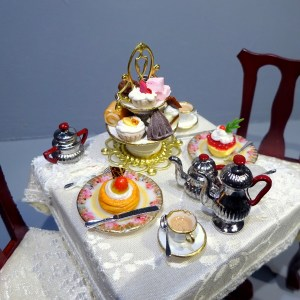 TEA FOR TWO TABLE complete with silver teaset and handmade cakes.