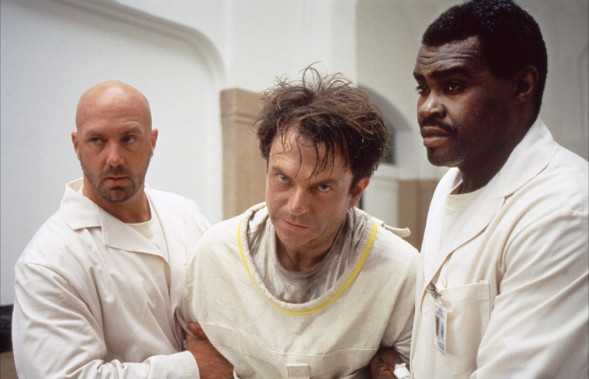 Sam Neill (center) in In the Mouth of Madness