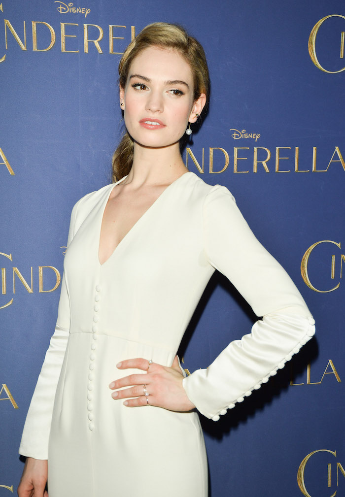 "Toronto, March 11: Lily James (in Dior with Aquazzura shoes and Olympia leTan bag), star of the highly-anticipated, critically-acclaimed ""CINDERELLA,"" delights audiences at a screening of the film at Scotiabank Theatre, on the latest stop of the film's worldwide tour. photo: George Pimentel"
