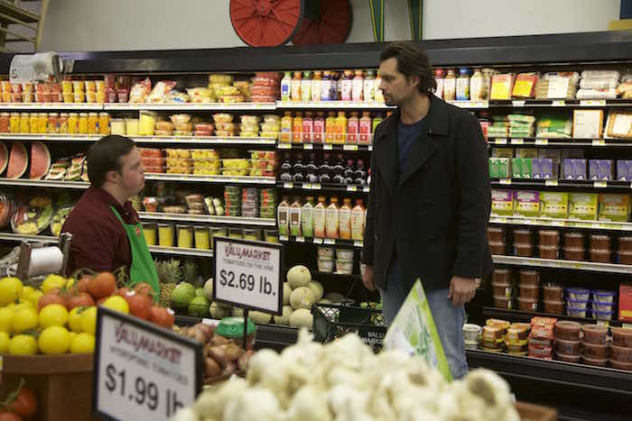 "Kristoffer Polaha (""Calvin"") meets David DeSanctis (""Produce"") in a scene from Roadside Attractions' ""Where Hope Grows."" Photo credit: Tom LeGoff"