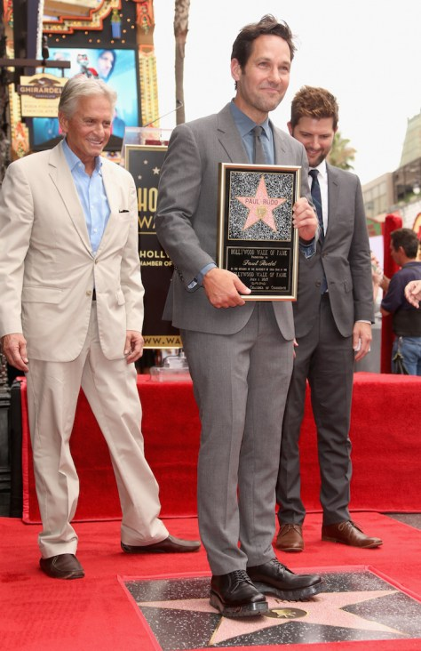 HOLLYWOOD, CA - JULY 01:  Actor Paul Rudd (C) with actors Michael Douglas (L) and Adam Scott as he is honored with a star on the Hollywood Walk Of Fame on July 1, 2015 in Hollywood, California.  (Photo by Jesse Grant/Getty Images for Disney)