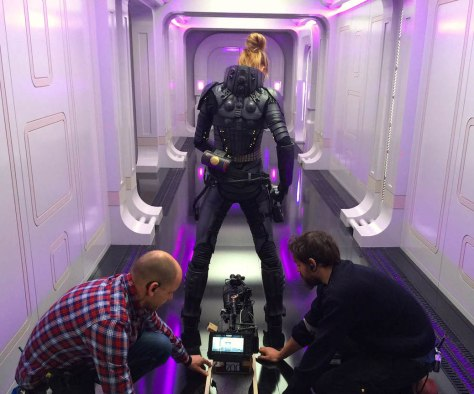 Cara In Suit   The crew prepares for a scene with star Cara Delevingne (center)of EuropaCorp's  Valerian and the City of a Thousand Planets. Photo credit: Luc Besson © 2016 VALERIAN SAS – TF1 FILMS PRODUCTION
