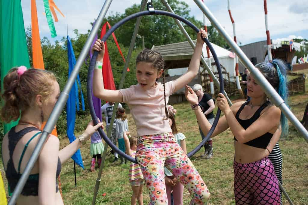 Young girl swinging in a hoop