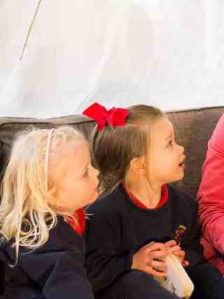 Highfield and Brookham Nursery Assistant reading with nursery children