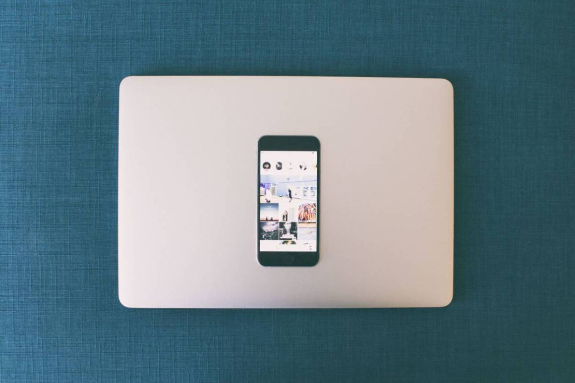 Instagram on mobile with a laptop