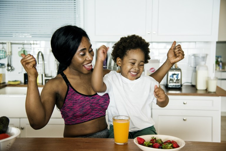 mother eating healthy with child post-workout snack
