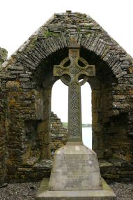 An arched and gated entranceway introduces the observer to this high cross located within a small chapel that was later built to the east of the south transept of Timoleague Friary