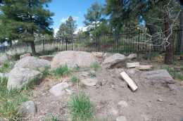 This before picture shows the sloped, underutilized backyard. This is the site of the pondless water feature and rock wall.