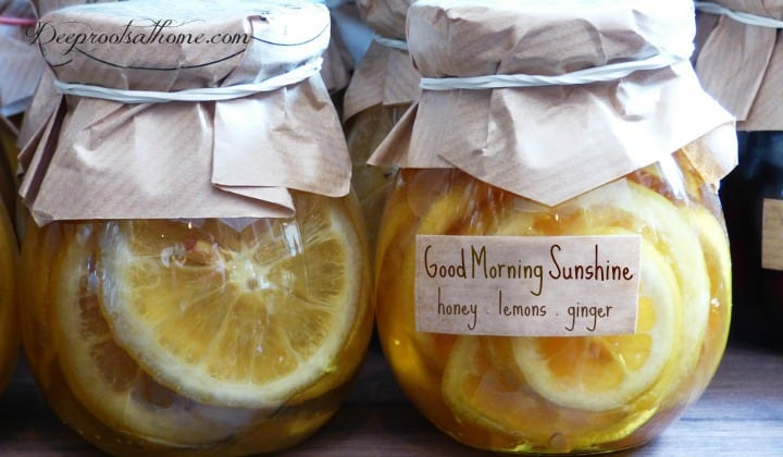 My 'Good-Morning-Sunshine' Drink: Honey & Lemons In Warm Water, body, morning, get going, coffee, tea, pure water, brain, dehydration, starving, energy, fluids, function, sleep, juice, memes, internet, wonders, healthm habitual, lemon water, therapeutic properties, powerful, restorative, medicine, delicious duo, strawberries and chocolate, bacon and eggs, food pair, cleanse, liver, toxins, lose weight, clear up skin, culinary combo, raw honey, ingredients, sunny window, ginger, knobs, slices, immerse, goal, properties, recipe, directions, empty stomach, alkalinize, enzymes, amino acids, minerals, nutritive, digestion, stomach acid production, bile secretion, research, don't heat honey, detoxify, detoxification, diuretic, flushing, urine, constipation, acidic, citric acid, sodium citrate, urinary tract infections, kidney stones, burning, acne, respiratory tract, obesity, reduce stress levels, improve mood, jars of prepared honeyed lemons, lemon slices, label