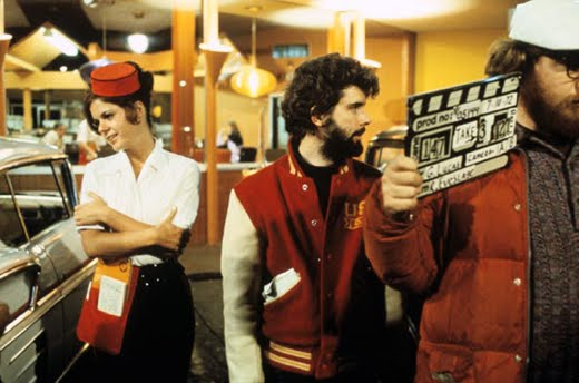 The outfits worn by the carhops in the film (including roller skates) were not typical garb for the Mels employees.