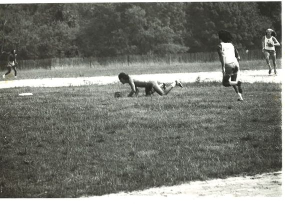Bruce Springsteen, playing second base, diving in vain for a sharply hit ball through the infield. That's Flashmaker (Steven 'Buck') Baker running to second base. In the outfield, Bruce roadie Natty Dread moves in to field the ground ball. (Photo: Ira Mayer)