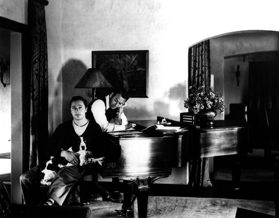Harold Arlen (with dog on lap) and Yip Harburg working on 'Last Night When We Were Young'
