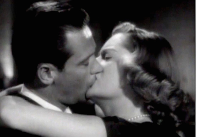 Alexis Smith in a tender moment with William Holden in The Turning Point: 'Bookish, smart, wry, and a bit cool, she foils Holden's natural cynicism…'