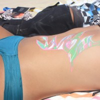 Body Painting On A Surf Beach