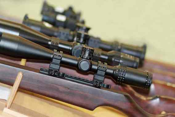 Stand With Hunting Rifles With Telescopic Sights. Weapon